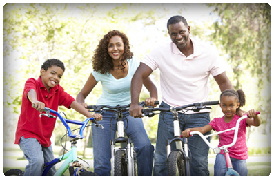 bigstock_Young_Family_Riding_Bikes_In_P_13909514 copy
